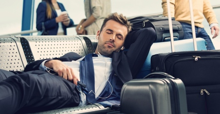 man-sleeping-at-airport